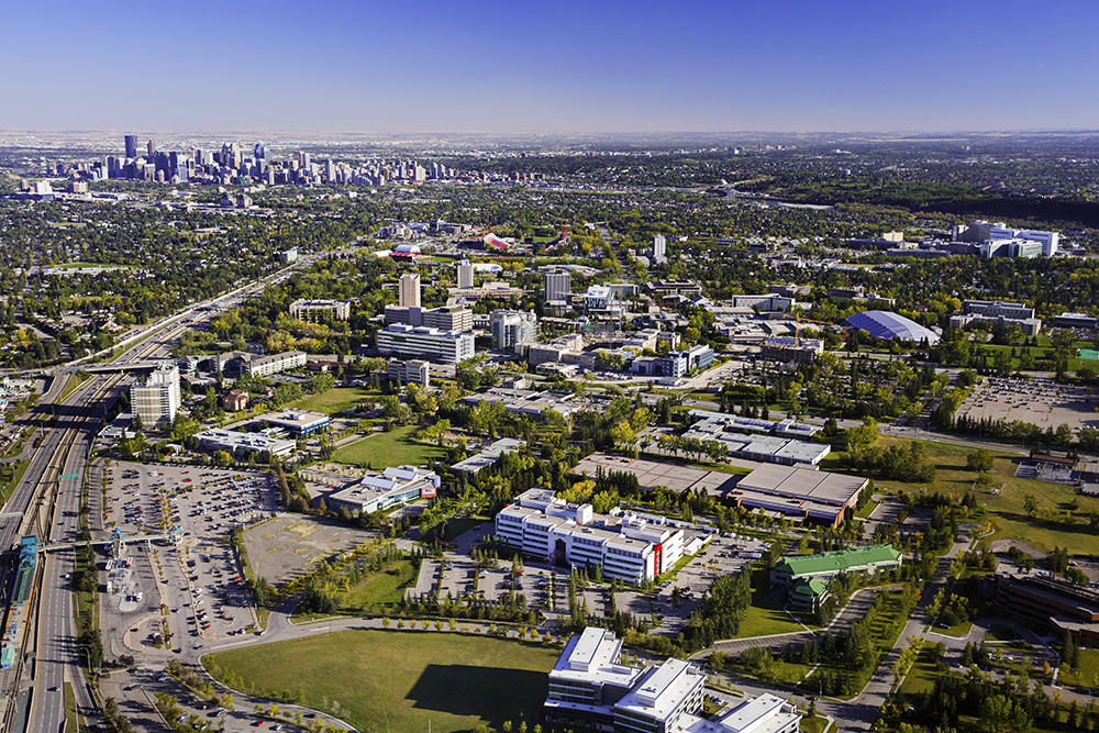 Aerial photograph of UCalgary campus with downtown Calgary in background